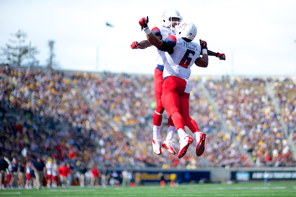 Arizona wide receiver Nate Phillips celebrates his second-quarter touchdown with Arizona wide receiver Samajie Grant during the NCAA football game between the California Golden Bears and the Arizona Wildcats at Memorial Stadium in Berkeley, CA.