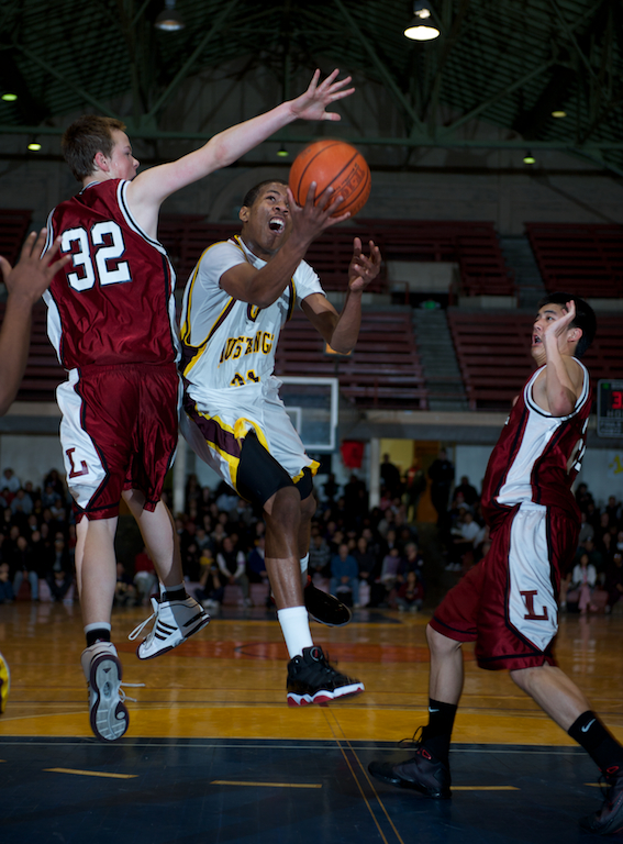 Lowell's Robbie Pollard tries to block a shot from Lincoln's Deend Parker.